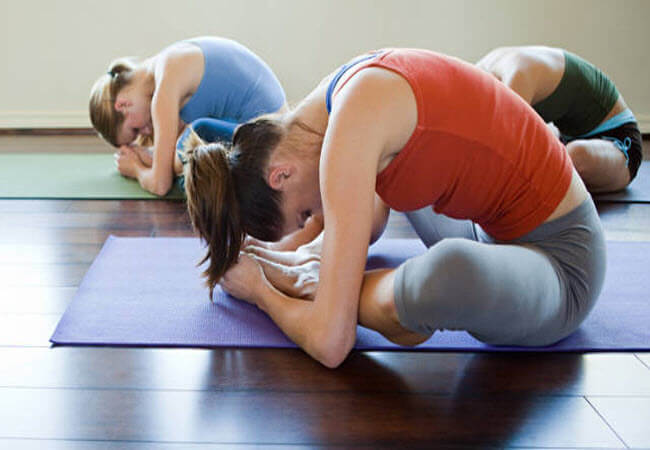 йога при болях у спині