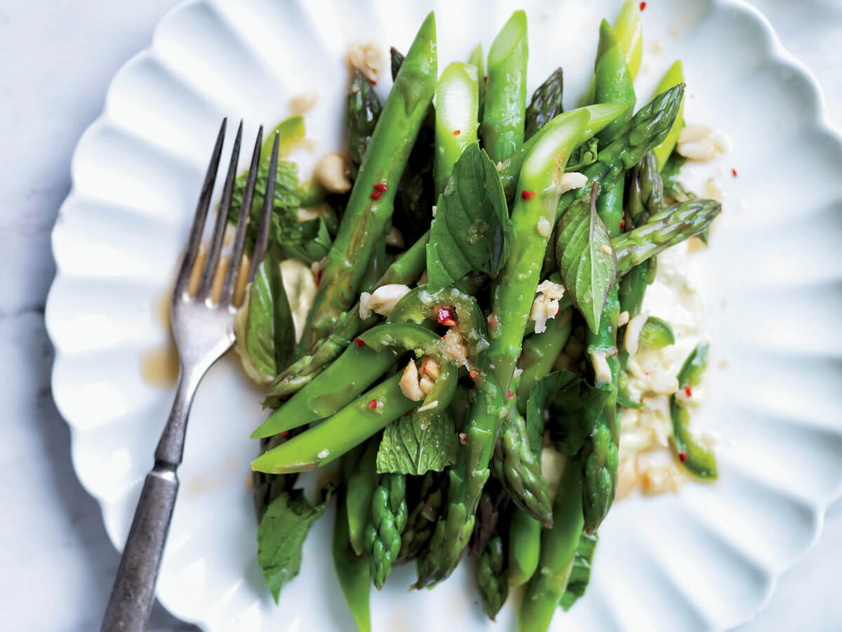 Warm salad from asparagus, walnuts and arugula - dietary recipe for New year's table